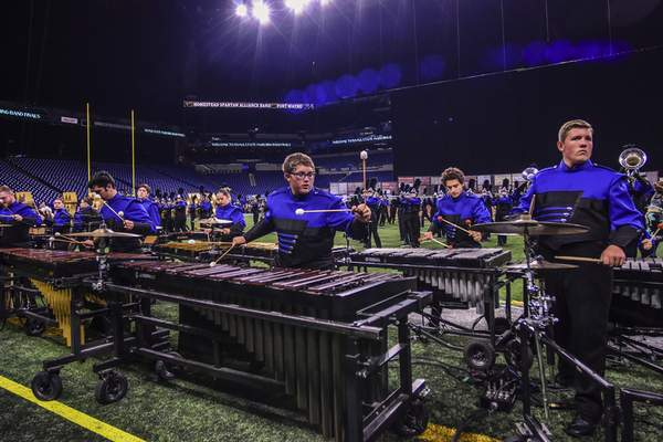 Mike Moore | The Journal Gazette Elijah Dressel, center plays the xylophone while performing with the Homestead High School Marching Band during the ISSMA State Marching Band Finals at Lucas Oil Stadium in Indianapolis on Saturday.