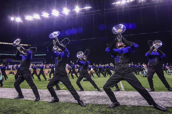 Mike Moore | The Journal Gazette Members of the Homestead High School Marching Band perform during the ISSMA State Marching Band Finals at Lucas Oil Stadium in Indianapolis on Saturday.