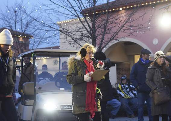 Host Barb Richards addresses the crowd at the tree lighting ceremony, which dates to 2002, a year after the shopping center opened.