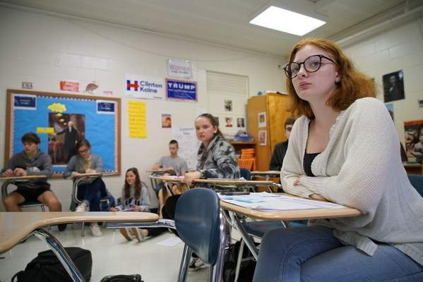Associated Press Emma Preston listens during civics class at Chatham Central High School in Bear Creek, N.C., on Tuesday, when the class debated whether President Trump should be impeached.