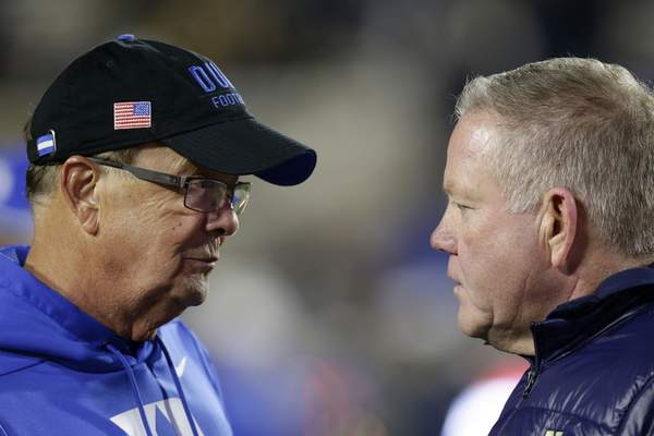 Notre Dame's Brian Kelly and Duke's David Cutcliffe meet after the Irish's 38-7 win over the Blue Devils on Saturday.(AP Photo/Gerry Broome)