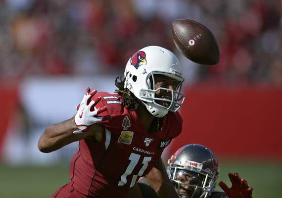 Arizona Cardinals wide receiver Larry Fitzgerald (11) prepares to make a catch in front of Tampa Bay Buccaneers cornerback M.J. Stewart (36) during the first half of an NFL football game Sunday, Nov. 10, 2019, in Tampa, Fla. (AP Photo/Jason Behnken)