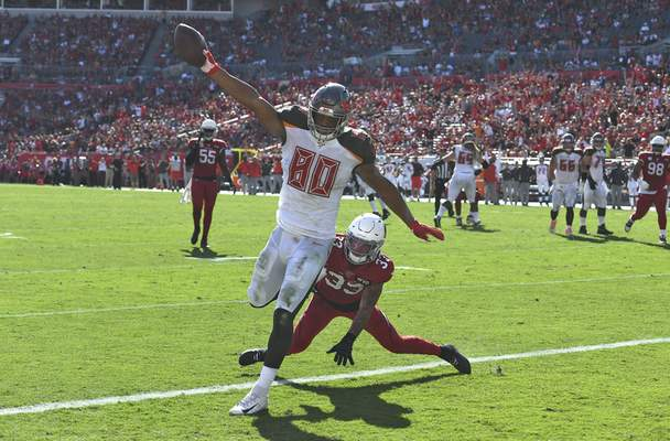 Tampa Bay Buccaneers tight end O.J. Howard (80) scores past Arizona Cardinals cornerback Byron Murphy (33) on a 10-yard touchdown reception during the first half of an NFL football game Sunday, Nov. 10, 2019, in Tampa, Fla. (AP Photo/Jason Behnken)