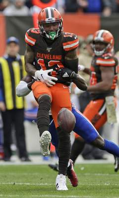Cleveland Browns wide receiver Odell Beckham Jr. (13) cannot hold onto pass under pressure from Buffalo Bills cornerback Tre'Davious White during the first half of an NFL football game, Sunday, Nov. 10, 2019, in Cleveland. (AP Photo/Ron Schwane)