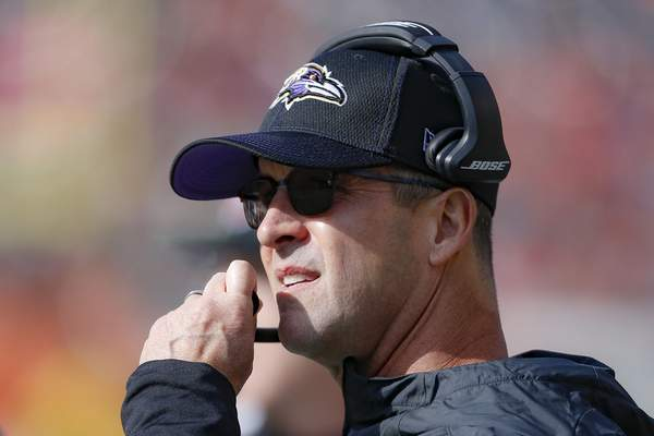 Baltimore Ravens head coach John Harbaugh works the sidelines during the first half of NFL football game against the Cincinnati Bengals, Sunday, Nov. 10, 2019, in Cincinnati. (AP Photo/Gary Landers)