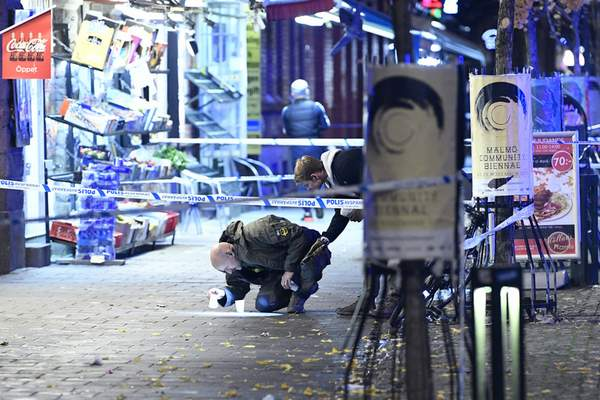 In this photo taken late Saturday, Nov. 9, 2019, a policeman works near the scene of a shooting, in Malmo, Sweden. (Johan Nilsson/TT News Agency via AP)