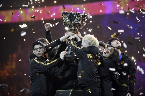 Team FunPlus Phoenix hold the trophy as they celebrate after winning the final of League of Legends tournament against Team G2 Esports, in Paris, Sunday, Nov. 10, 2019. (AP Photo/Thibault Camus)