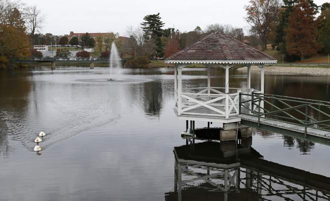 In this Monday, Nov. 4, 2019, photo, the principal spillway inlet under the gazebo redirects excess water out of the Muskingum University's lake, in New Concord, Ohio. (AP Photo/Tony Dejak)