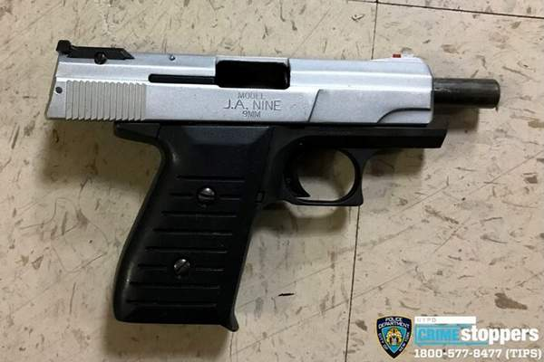 FILE - This Oct. 23, 2019 file photo provided by the New York Police Department shows a firearm recovered at the scene where police shot and killed a suspect in New York.  (New York Police Department via AP, File)