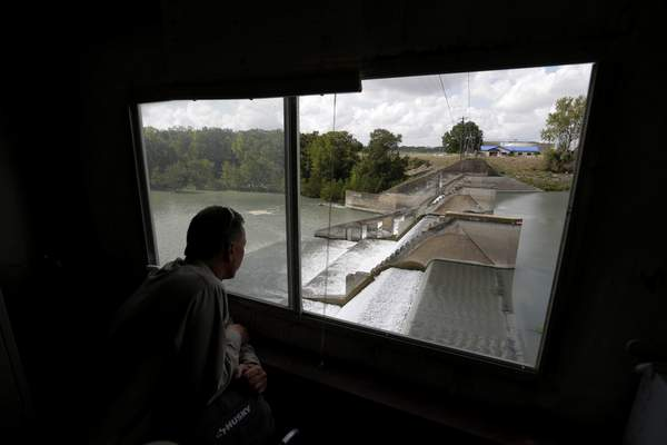 Guadalupe-Blanco River Authority's John Moryl looks over the spill gates at Lake Dunlap, Oct. 2, 2019, in Lake Dunlap, Texas. (AP Photo/Eric Gay)