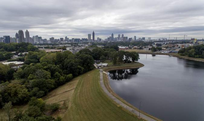 Reservoir No. 1, a 180 million-gallon water supply that has been out of service much of the past few decades, sits against the backdrop of the city skyline, Oct. 15, 2019, in Atlanta. (AP Photo/David Goldman)