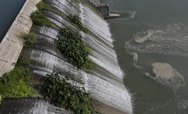 Water flows over a spill gate on Lake McQueeney, Oct. 2, 2019, Lake McQueeney, Texas. (AP Photo/Eric Gay)