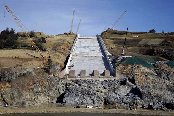 FILE - In this Nov. 30, 2017, file photo, work continues on the Oroville Dam spillway in Oroville, Calif. The scare at Oroville, the nation's tallest dam, led to evacuation orders for nearly 200,000 people, although no one was injured and the dam ultimately held. (AP Photo/Rich Pedroncelli, File)