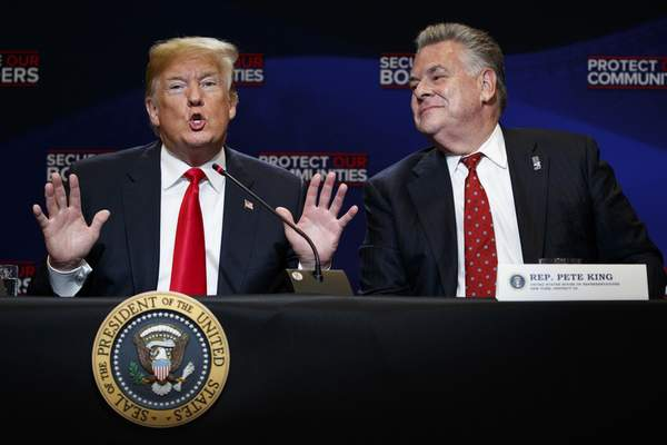 FILE - In this May 23, 2018, file photo, Rep. Peter King, R-N.Y., right, listens as President Donald Trump speaks during a roundtable on immigration policy at Morrelly Homeland Security Center in Bethpage, N.Y. (AP Photo/Evan Vucci, File)