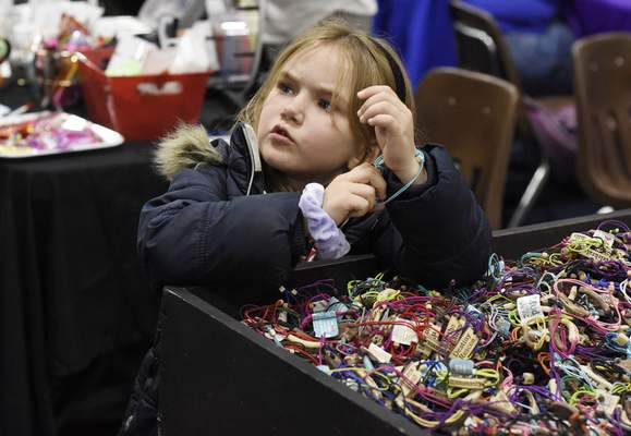 Rachel Von Stroup   The Journal Gazette Willow Hunter, 6, tries on MudLove Bands during the Girls World Expo at Turnstone Center For Children and Adults with Disabilities in Fort Wayne, IN on Sunday November 10, 2019.