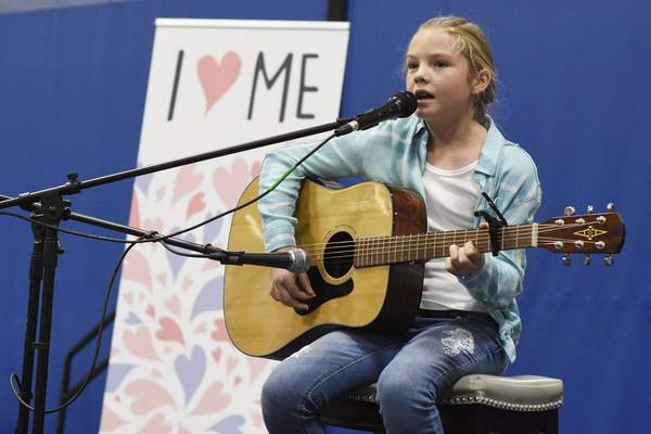 Rachel Von Stroup   The Journal Gazette Makora Stacey, 11, performs on stage during the Girls World Expo at Turnstone Center For Children and Adults with Disabilities in Fort Wayne, IN on Sunday November 10, 2019.