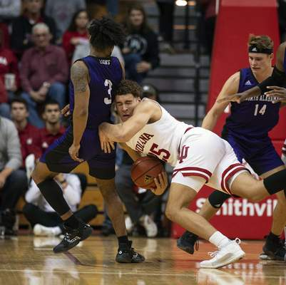 Indiana's Race Thompsontries to corral a loose ball during Indiana's 91-65 win over North Alabama on Tuesday. Thompson had five points and four rebounds.(AP Photo/Doug McSchooler)