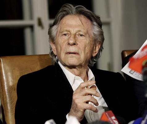 FILE - In this Oct. 30, 2015, file photo, filmmaker Roman Polanski tells reporters he can breath with relief after a Polish judge ruled that the law forbids his extradition to the U.S., in Krakow, Poland. (AP Photo/Jarek Praszkiewicz, File)