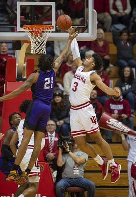Associated Press Indiana's Justin Smith blocks the shot of North Alabama's Emanuel Littles during the first half of Tuesday's game in Bloomington.