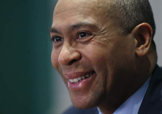FILE - In this Dec. 15, 2014, file photo, Massachusetts Gov. Deval Patrick speaks during an interview at his Statehouse office in Boston. (AP Photo/Elise Amendola, File)