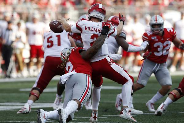 FILE - In this Sept. 21, 2019, file photo, Ohio State defensive end Chase Young, left, sacks Miami (Ohio) quarterback Jackson Williamson causing a fumble during the first half of an NCAA college football game, in Columbus, Ohio. Ohio State says defensive end Chase Young won't play Saturday against Maryland because of a possible NCAA