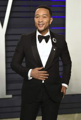 FILE - This Feb. 24, 2019 file photo shows John Legend at the Vanity Fair Oscar Party in Beverly Hills, Calif. (Photo by Evan Agostini/Invision/AP, File)