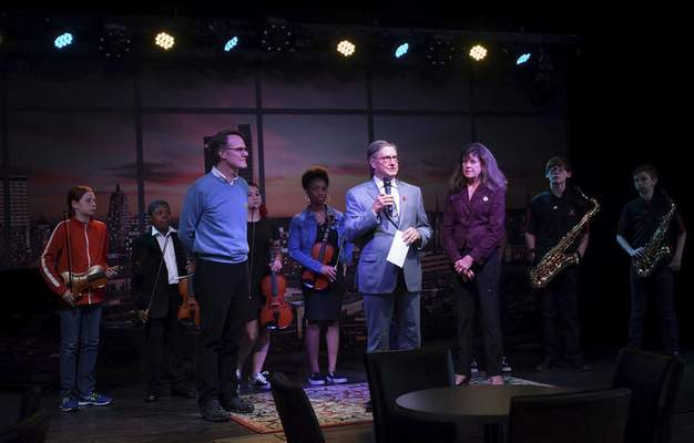 Announcing the fundraising campaign and introducing Memorial Park Middle School performers are, from left, Paul Spoelhof, Tom Borne and Pamela Kelly at Sweetwater Sound on Wednesday.