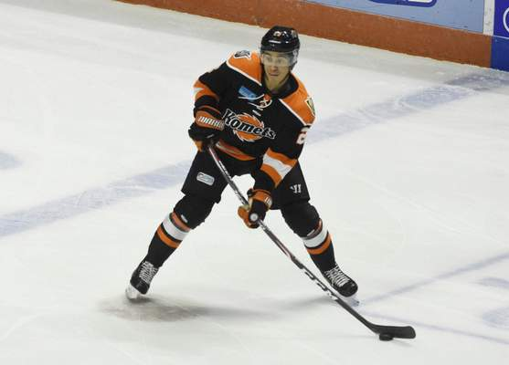 Rachel Von Stroup | The Journal Gazette  Komets' Max Gottlieb prepares to pass the puck during the second period against the Kalamazoo Wings at the Memorial Coliseum on Friday night.