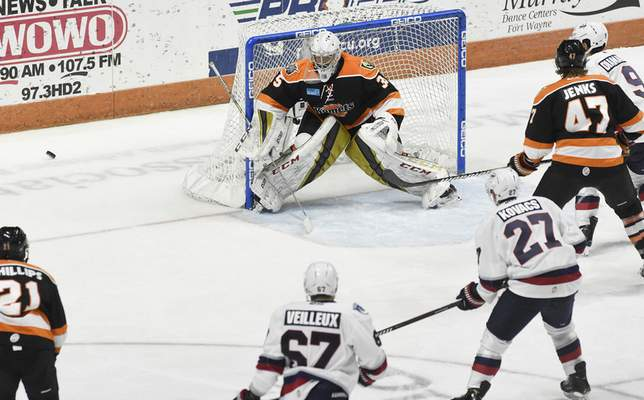 Rachel Von Stroup | The Journal Gazette  Komets' Dylan Ferguson guards the goal during the second period against the Kalamazoo Wings at the Memorial Coliseum on Friday night.
