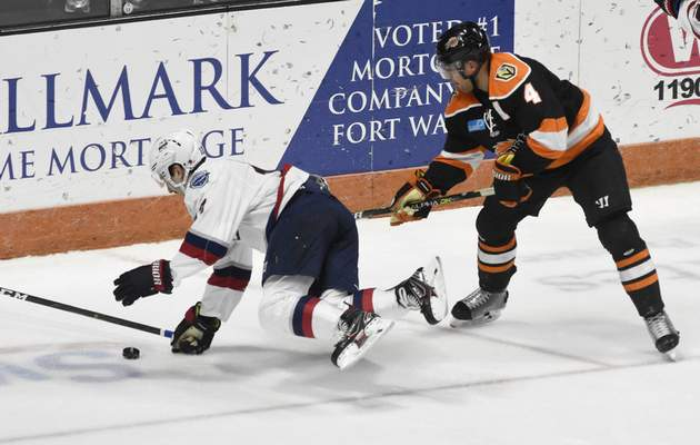 Rachel Von Stroup | The Journal Gazette  Komets' Jason Binkley pushes down Wings' Aaron Thow during the second period at the Memorial Coliseum on Friday night.