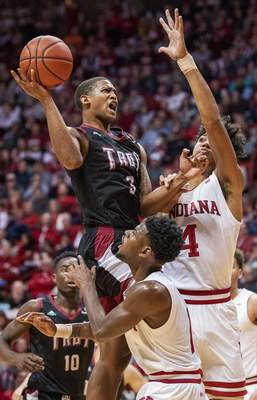 Troy's Darian Adams goes up for the shot between Indiana's Trayce Jackson-Davis (4) and Al Druham (1) during an NCAA college basketball game Saturday, Nov. 16, 2019, in Bloomington, Ind. (Rich Janzaruk/The Herald-Times via AP
