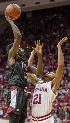 Troy's Zay Willimas shoots over Indiana's Jerome Hunter during an NCAA college basketball game Saturday, Nov. 16, 2019, in Bloomington, Ind. (Rich Janzaruk/The Herald-Times via AP)