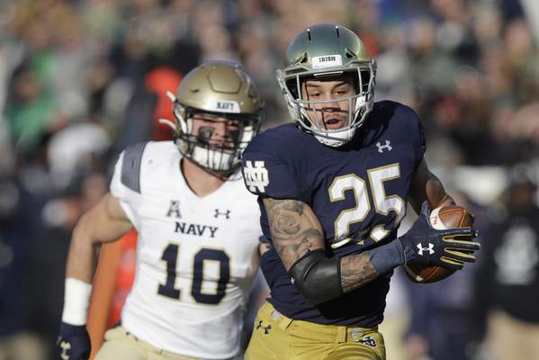 Notre Dame wide receiver Braden Lenzy runs for a 70-yard touchdown catch against Navy. The touchdown was one of five scoring passes from quarterback Ian Book in Notre Dame's 52-20 win. (AP Photo/Darron Cummings)