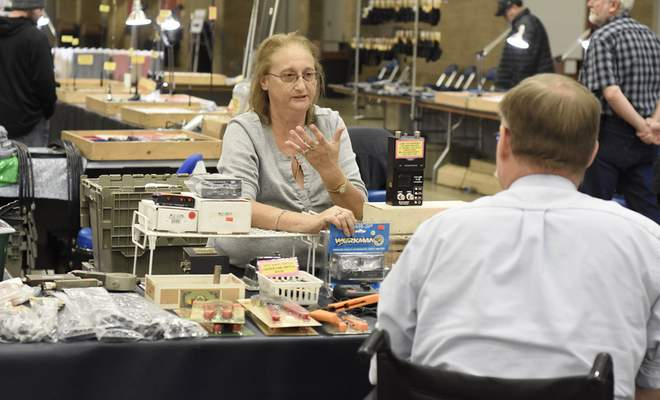 Rachel Von Stroup | The Journal Gazette  Jill Cole with Tower Electronics talks about howshe and her husband Scott are among the longest-standing vendors at the Fort Wayne Hamfest and Computer Expo at the Memorial Coliseum on Sunday.