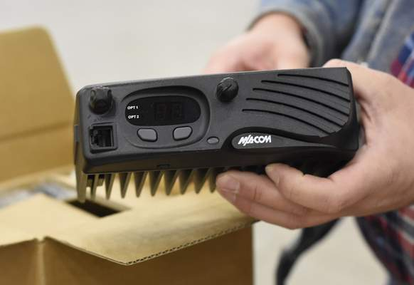 Rachel Von Stroup | The Journal Gazette John Welsh holds a VHF mobile radio Sunday. Ham radios remain important during disasters.