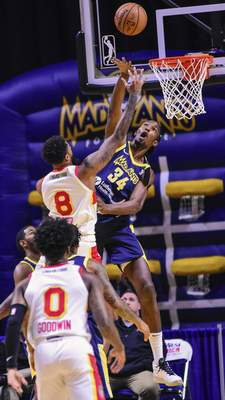 Mike Moore | The Journal Gazette Mad Ants center Hasheem Thabeet defends the basket in the first period against College Park at Memorial Coliseum on Monday.