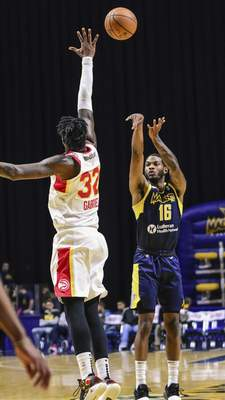 Mike Moore | The Journal Gazette Mad Ants guard C.J. Wilcox takes a shot at the basket in the second period against College Park at Memorial Coliseum on Monday.