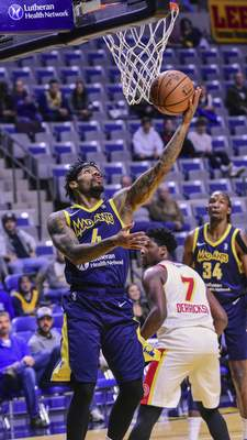 Mike Moore | The Journal Gazette Mad Ants guard Walt Lemon, Jr. scores under the basket in the first period against College Park at Memorial Coliseum on Monday.