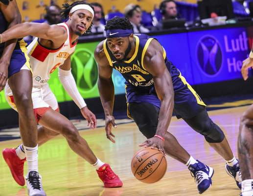 Mike Moore | The Journal Gazette Mad Ants guard Ike Nwamu drives to the basket in the first period against College Park at Memorial Coliseum on Monday.