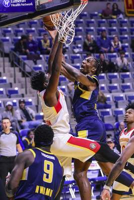Mike Moore | The Journal Gazette Mad Ants center Hasheem Thabeet scores under the basket in the first period against College Park at Memorial Coliseum on Monday.