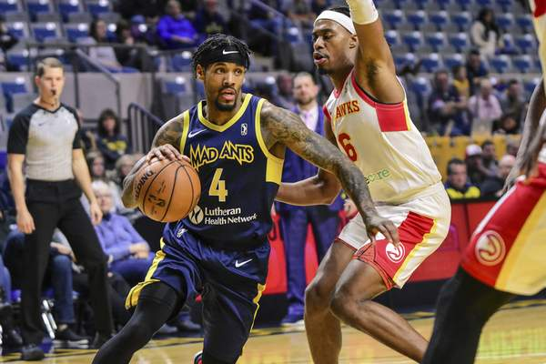 Mike Moore | The Journal Gazette Mad Ants guard Walt Lemon, Jr. dribbles under the basket in the second period against College Park at Memorial Coliseum on Monday.
