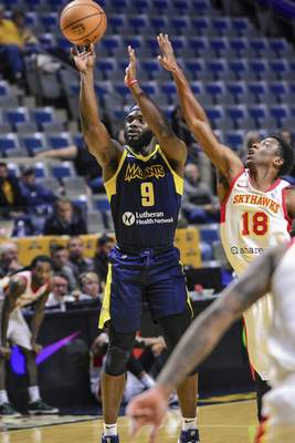 Mike Moore | The Journal Gazette Mad Ants guard Ike Nwamu takes a shot at the basket in the second period against College Park at Memorial Coliseum on Monday.