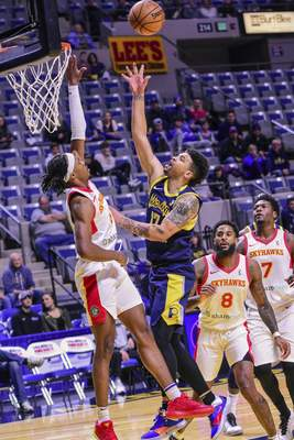 Mike Moore | The Journal Gazette Mad Ants guard Stephan Hicks takes a shot at the basket in the first period against College Park at Memorial Coliseum on Monday.
