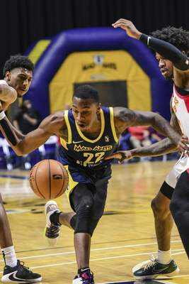 Mike Moore | The Journal Gazette Mad Ants guard Demetrius Denzel-Dyson chases down the ball after having it knocked away by College Park defenders in the second period at Memorial Coliseum on Monday.