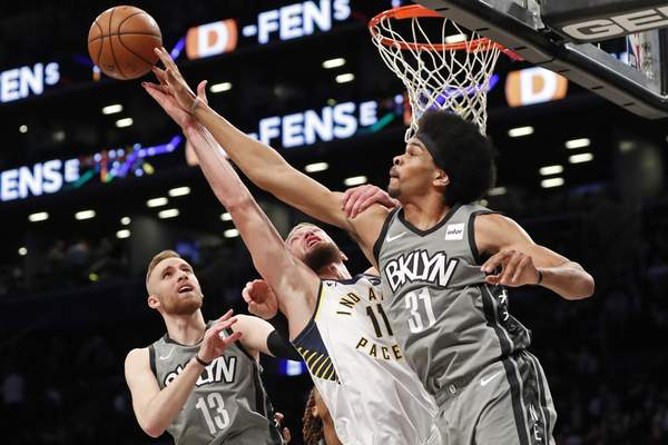 Associated Press Nets center Jarrett Allen tips the ball from Pacers forward Domantas Sabonis s Nets guard Dzanan Musa watches during the first half Monday in New York. Sabonis finished with 16 points.