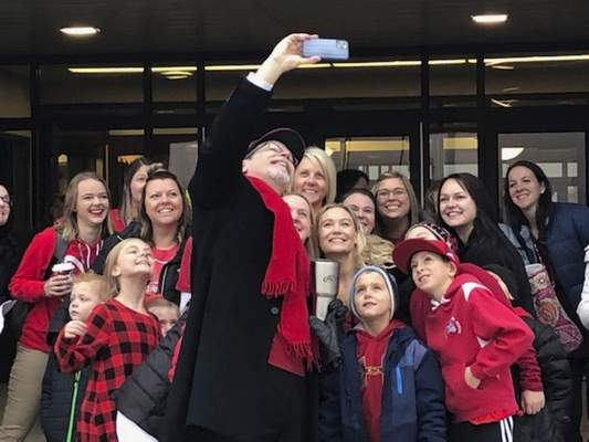 Brian Francisco |The Journal Gazette  Southwest Allen County Schools Supt. Phil Downs takes a photo with participants in the