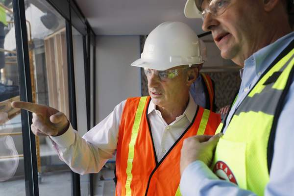 Associated Press Baseball Commissioner Rob Manfred tours the construction site for the new Texas Rangers stadium in Arlington, Texas, on Tuesday.