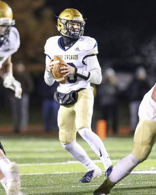 Bishop Dwenger junior QB Brenden Lytle drops back to throw a pass during the IHSAA Semi-State matchup against Valparaiso High School