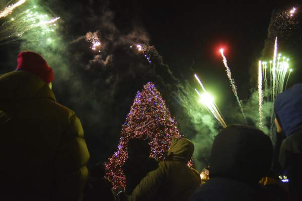 Fireworks light up the sky as the 40-foot blue spruce tree is lit Friday on Broadway. The event also included train rides, hot chocolate, and visits with Santa and Mrs. Claus and officially kicks off the holiday season in Fort Wayne. (Photos by Katie Fyfe | The Journal Gazette)