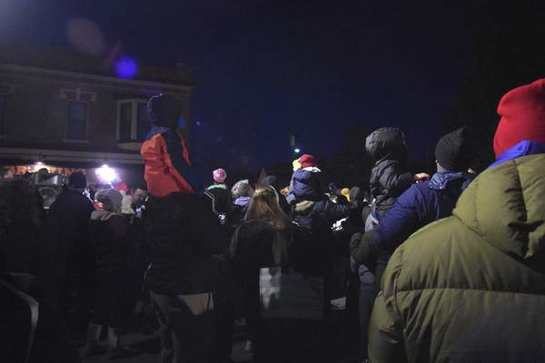 Crowds gather around to watch the tree lighting.